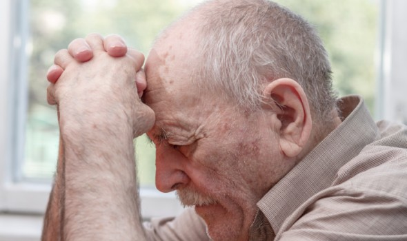 Depressed Old Man Sign of Nursing Home Abuse