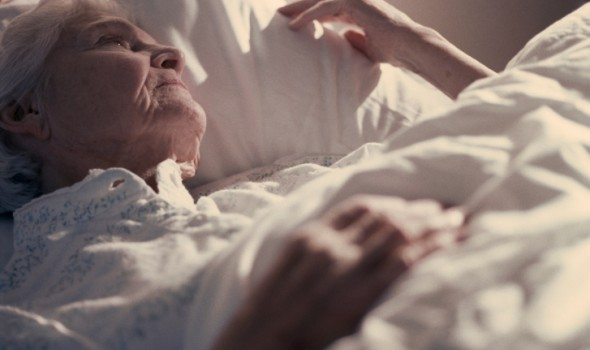 Injured Woman in Nursing Home Bed