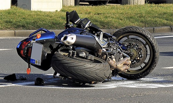 motorcycle accident in the road