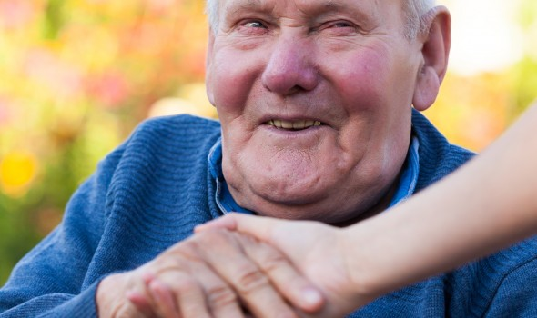 Old man holding a female hand, being happy.