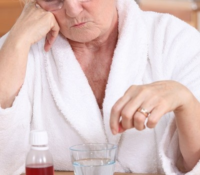 Elderly lady with her medication