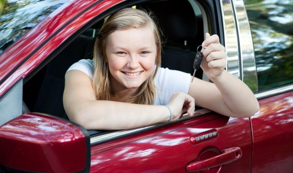 teen holding car keys