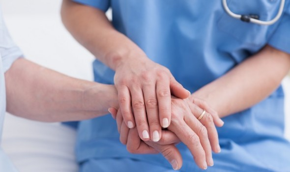 doctor touching a patient's hand