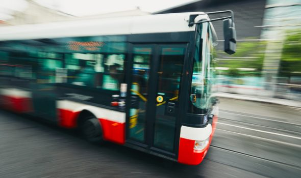 blurred fast moving bus